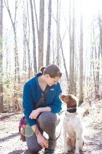Founder and Head Trainer, Eliza, hiking with her personal dog, Lally.